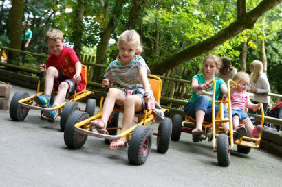 Children riding the MoonKarts at Greenwood Forest Park